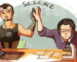 Tony stark and Bruce Banner high-five over science